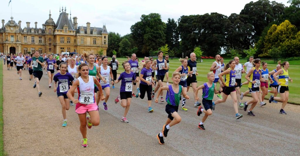 Road runners with a manor in background